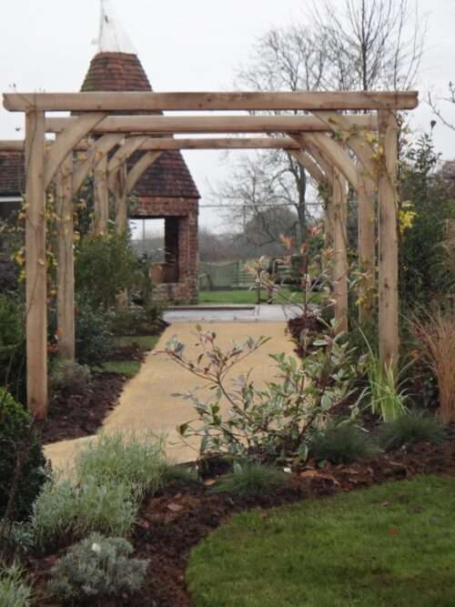 garden arches and archway over path in garden