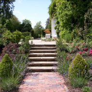 step-leading-to-patio-terrace-in-landscaped-garden