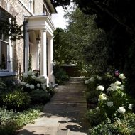 stone-path-walkway-leading-to-front-door-and-porch-using-yorkshire-paving-slabs