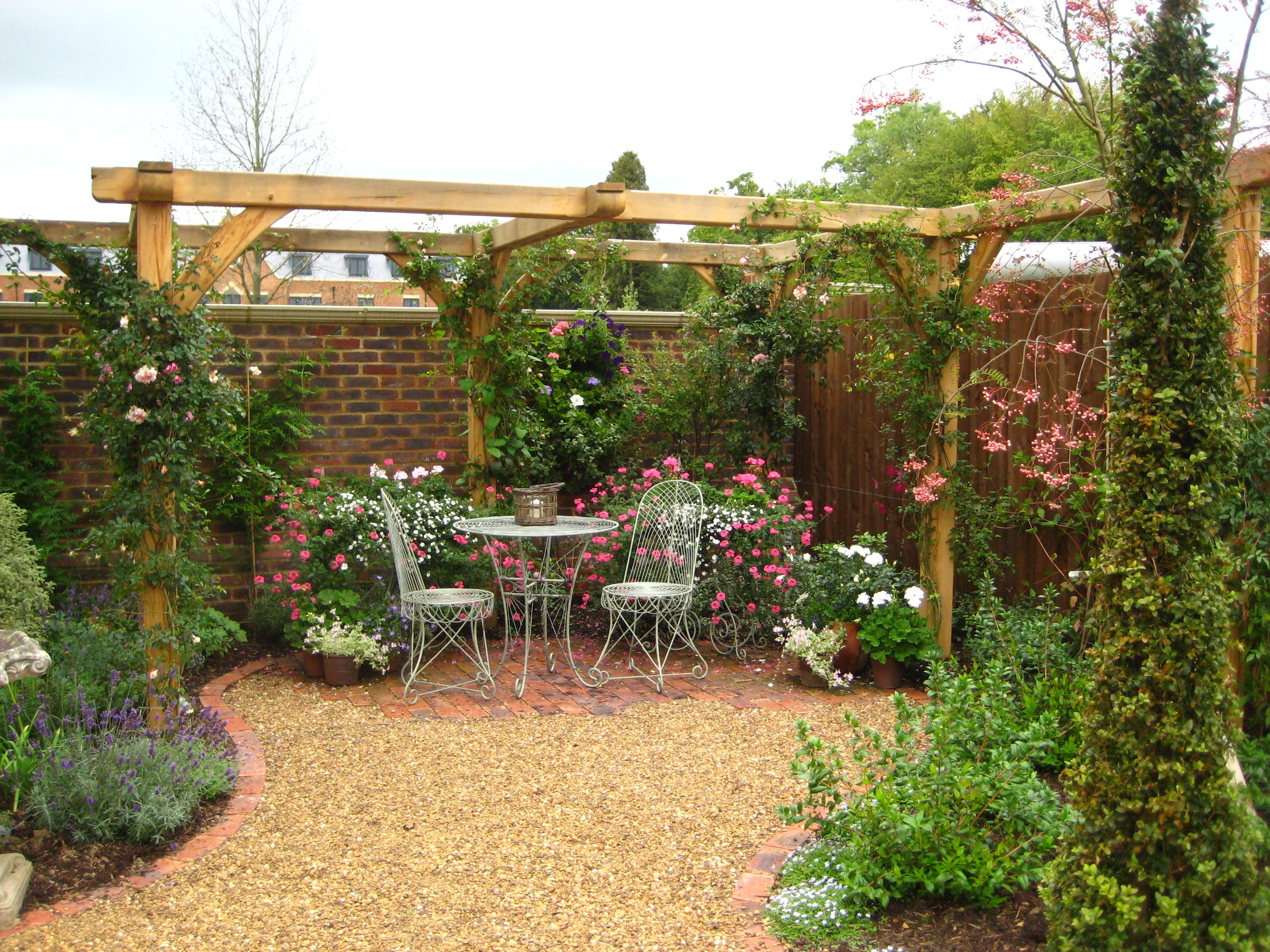 wooden pergola kit made from Oak frame in the garden for nice quiet seating corner area