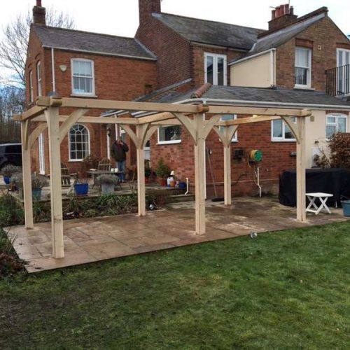 oak-pergola-traditional-and-natural-looking-garden-structure-on-paving-to-create-seating area